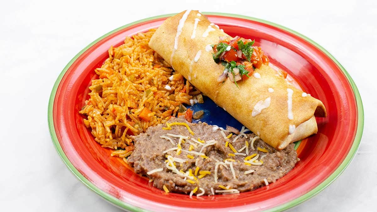 Air-Fried Chimichanga on a plate with refried beans and mexican rice
