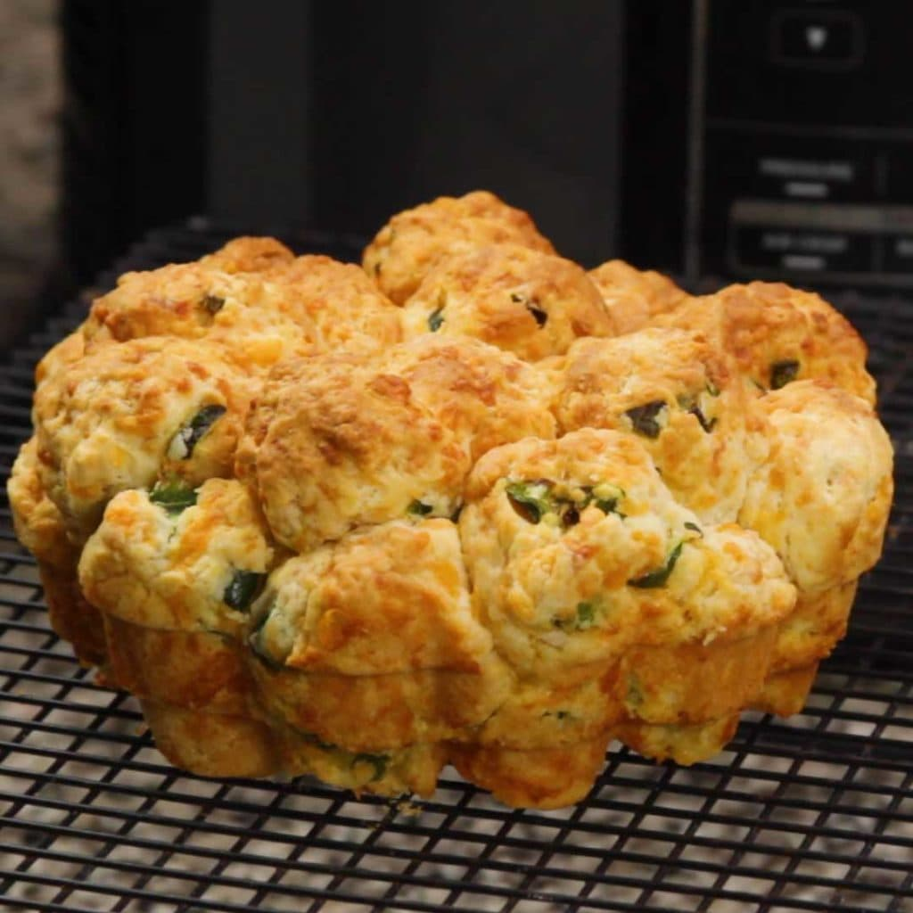 Jalapeno cheddar pull apart bread on a cooling rack