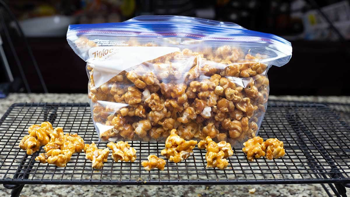 cooled popcorn in a ziplock bag on a cooling rack