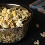 Ninja Foodi Popcorn in a mesh bowl with a DVD jacket behind it