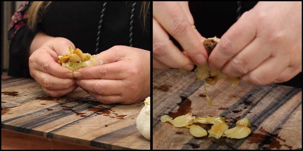 squeezing the cloves from the roasted garlic bulbs