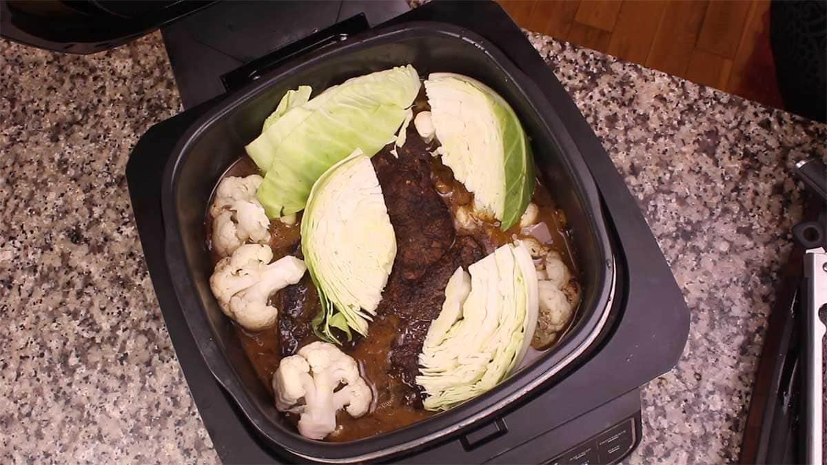 adding vegetables to pot roast