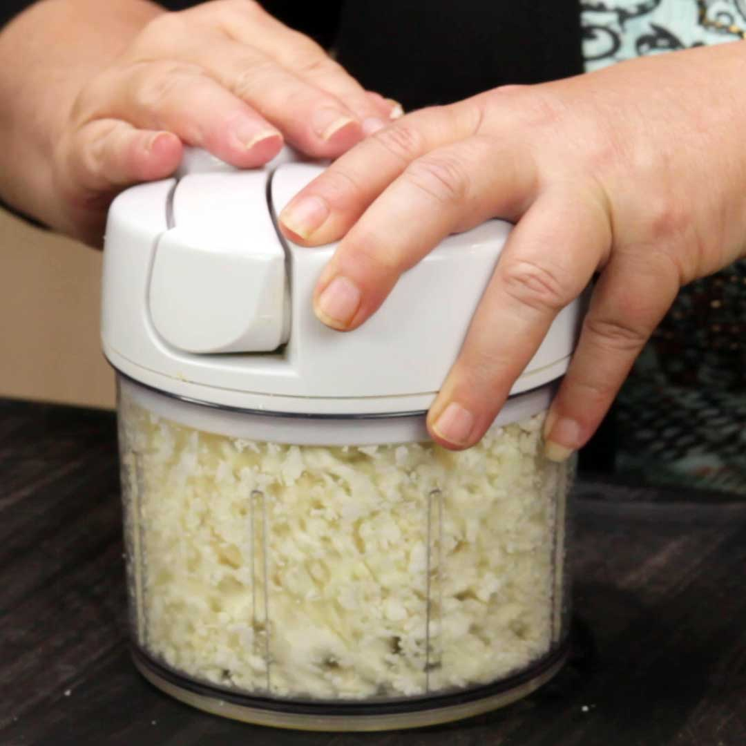 Making cauliflower rice with the Pampered Chef manual food processor