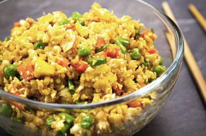 cauliflower fried rice in a glass bowl