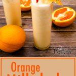 Orange Milkshakes with sliced oranges next to them and a full orange