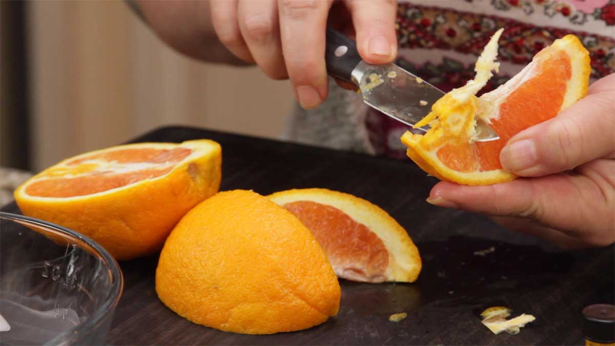 cutting oranges for orange milkshake
