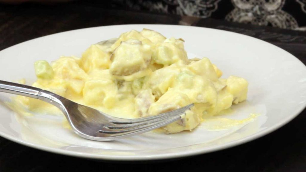 potato salad on a plate with a fork