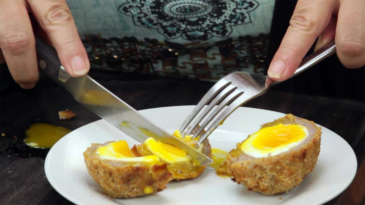 cutting open scotch eggs