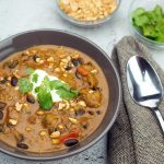 curry chicken chili in a bowl with garnish