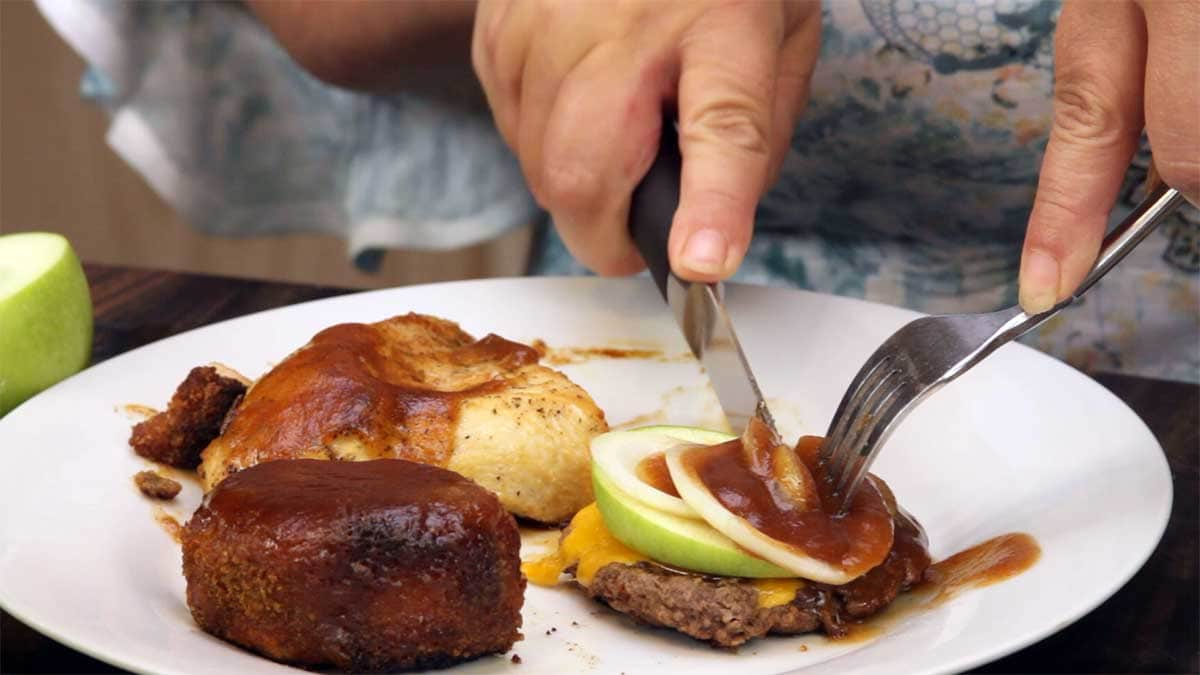 serving apple butter bourbon bbq sauce with pork, chicken, and a burger