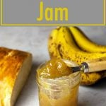 banana jam in a jar next to half a loaf of bread and a bunch of ripe bananas