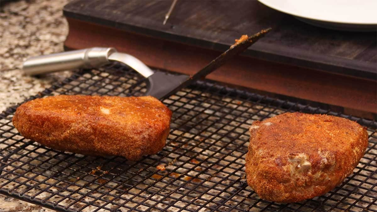 pork chops resting on a cooling rack