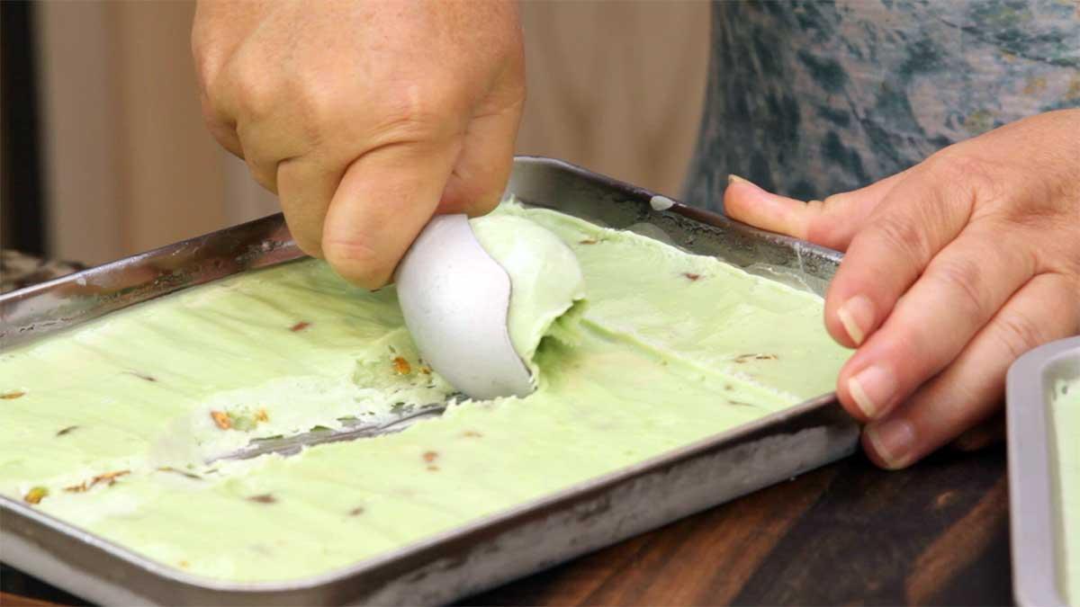 scooping pistachio ice cream