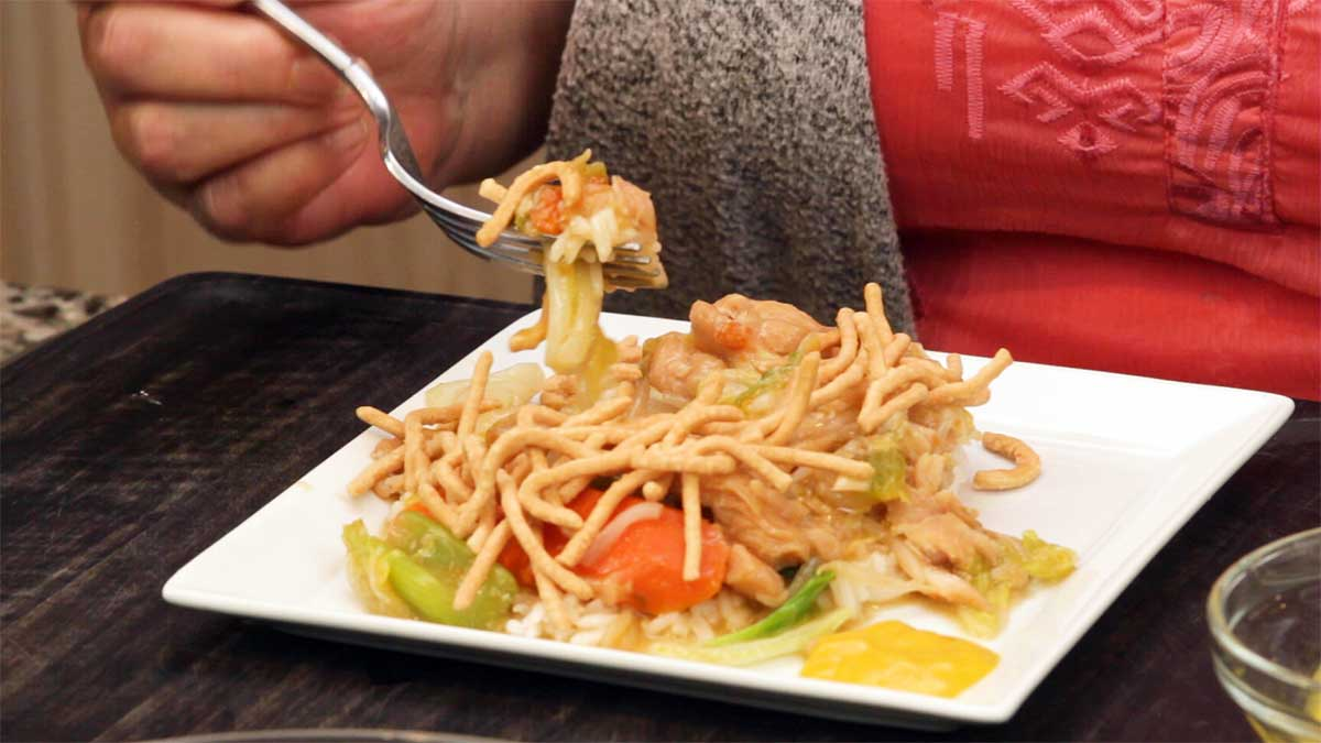 chicken chop suey on a plate with crispy noodles on top