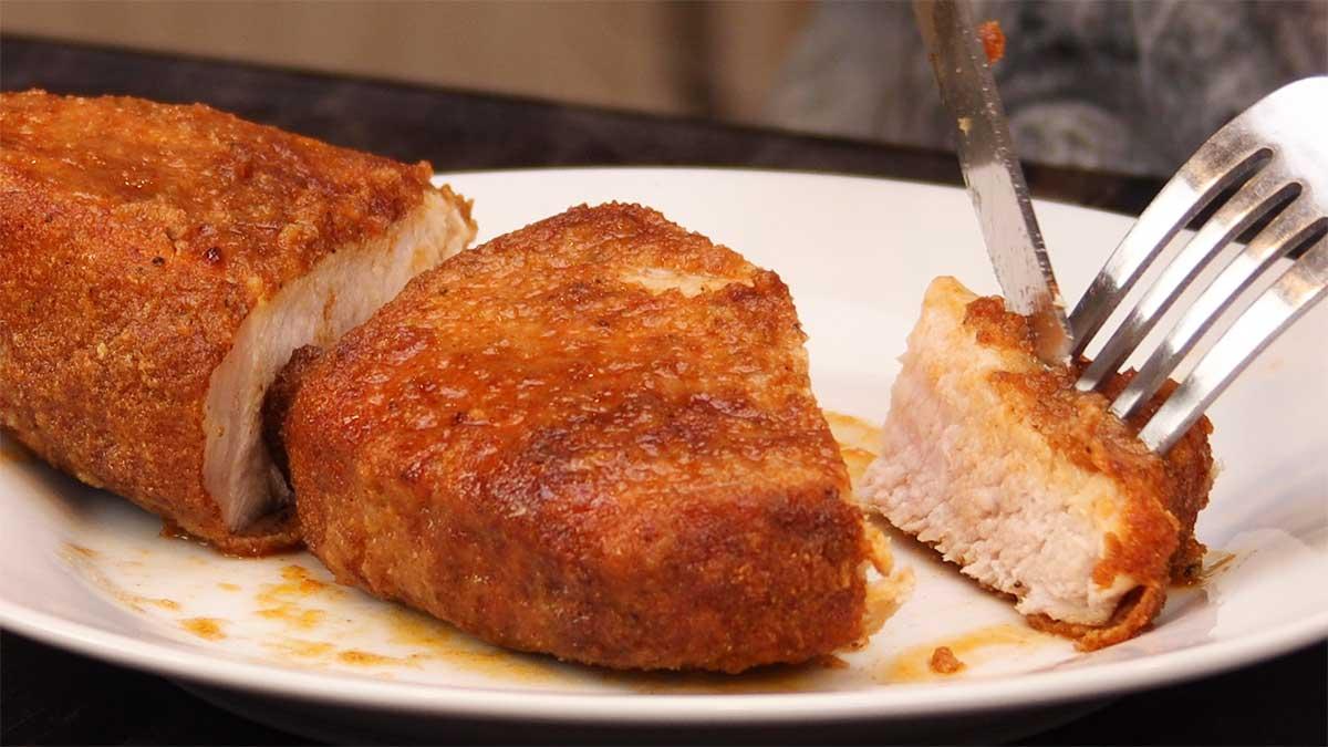 cutting into pork chop