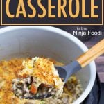 Cheesy Ground Beef and Rice Casserole in the Inner pot with a large spoon lifting out a serving