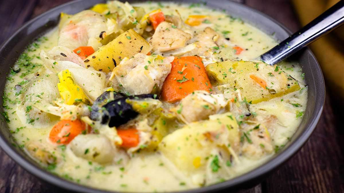 Chicken Stew in a bowl with a spoon