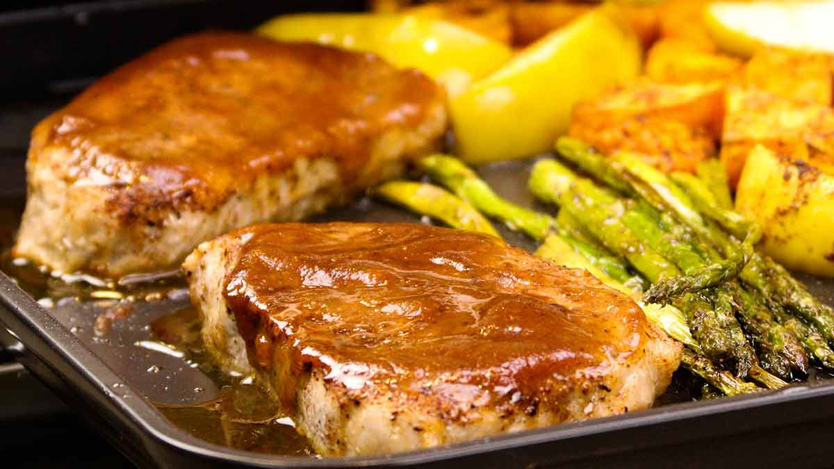 Pork chops on a sheet pan with sweet potatoes, apples, and asparagus
