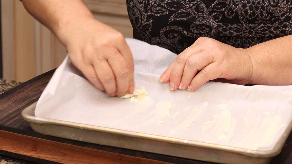 buttering a parchment lined tray