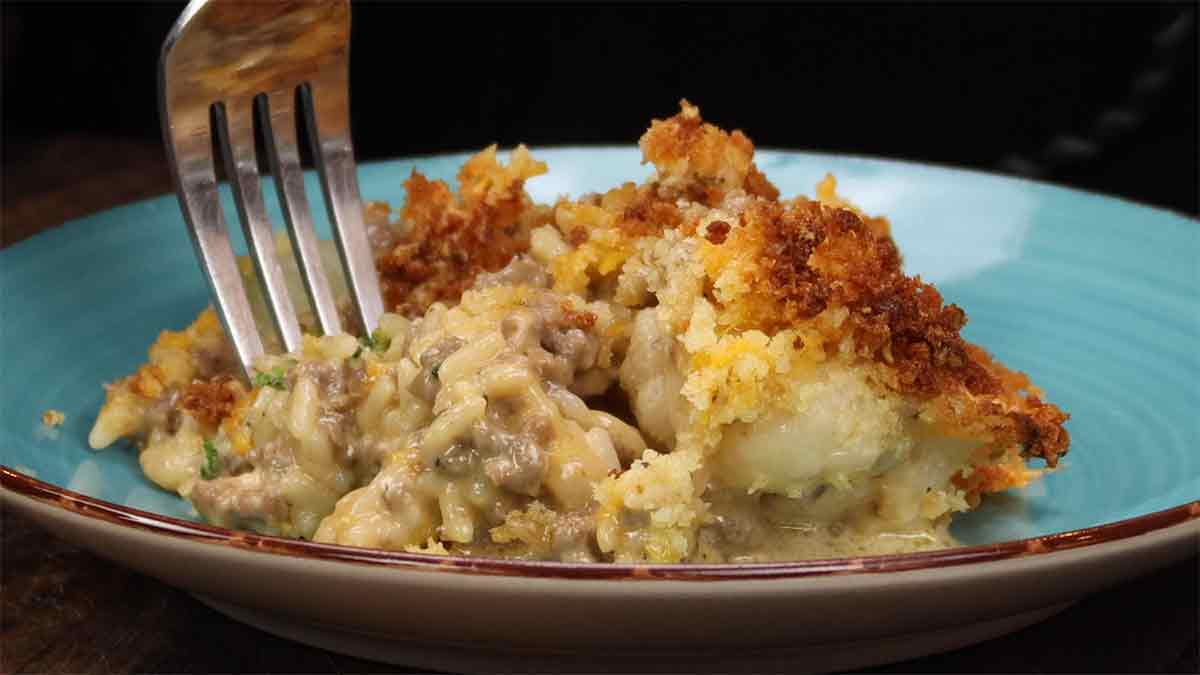 cheesy ground beef and rice casserole on a blue plate