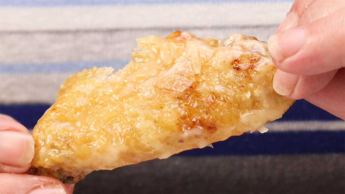 close up of a garlic parmesan wing