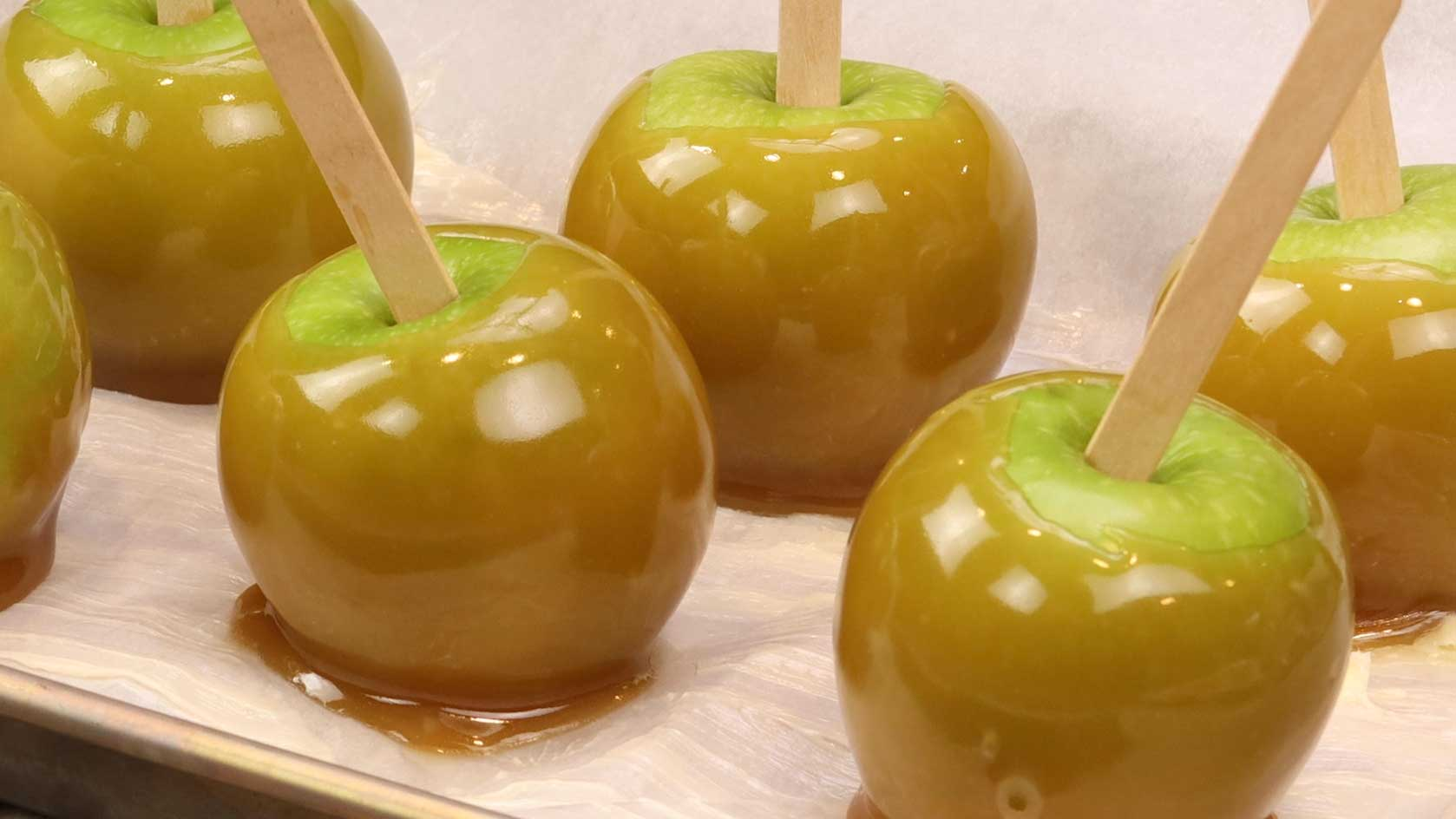 dipped apples on a tray