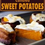 bacon wrapped candied sweet potatoes on a tray with one cut in. half