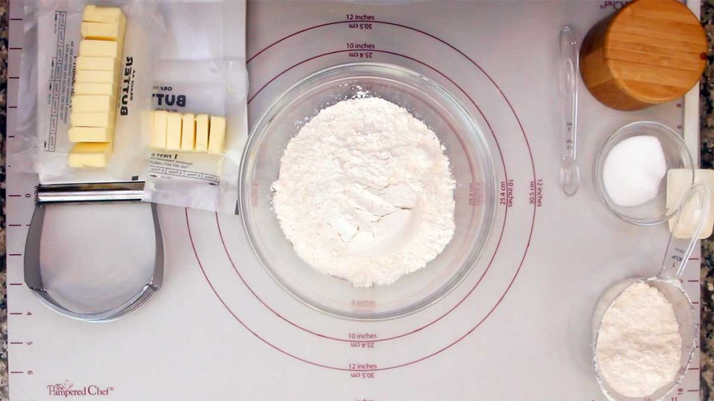 ingredients and tools used to make homemade pie dough