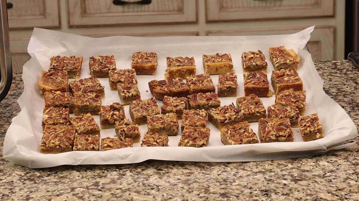 putting the pecan pie bars on a tray for freezing