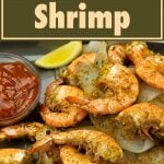 maryland style steamed shrimp on a platter with cocktail sauce