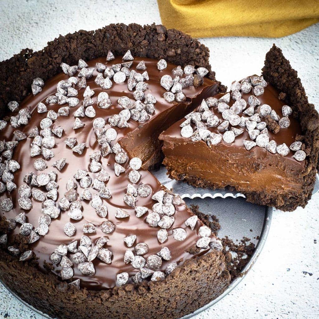 triple chocolate cheesecake with a slice being removed