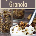 yogurt in a bowl with quinoa granola on top