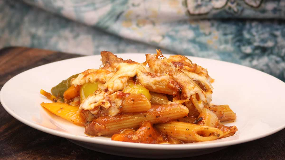 sausage peppers & pasta on a white plate