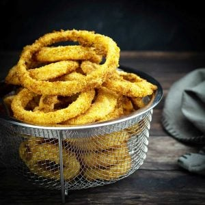 air fryer onion rings in a basket