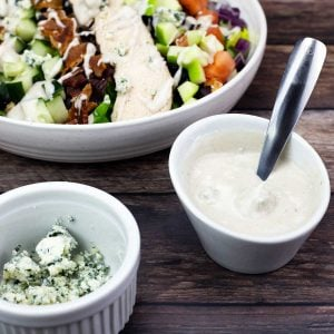 Blue Cheese Vinaigrette in a bowl next to a salad