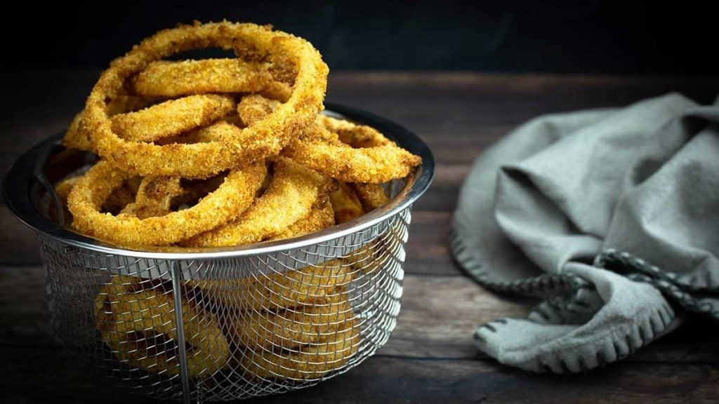 air fryer onion rings in a basket