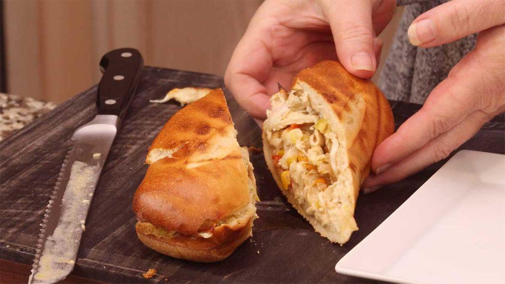 chicken cheesesteak cut in half