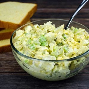 no peel egg salad in a bowl beside bread slices