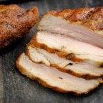 grilled pork tenderloin sliced on a cutting board