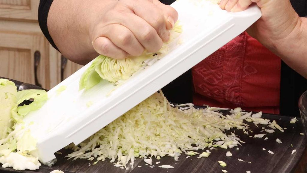 shredding cabbage using the vegetable strip maker from Pampered Chef