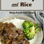 beef tips & rice with broccoli on a plate