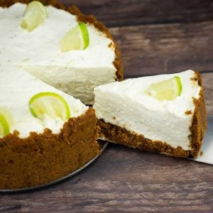 no bake key lime cheesecake with one slice being removed