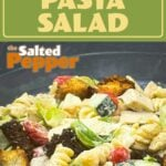 caesar pasta salad in a glass bowl with text above it saying caesar pasta salad