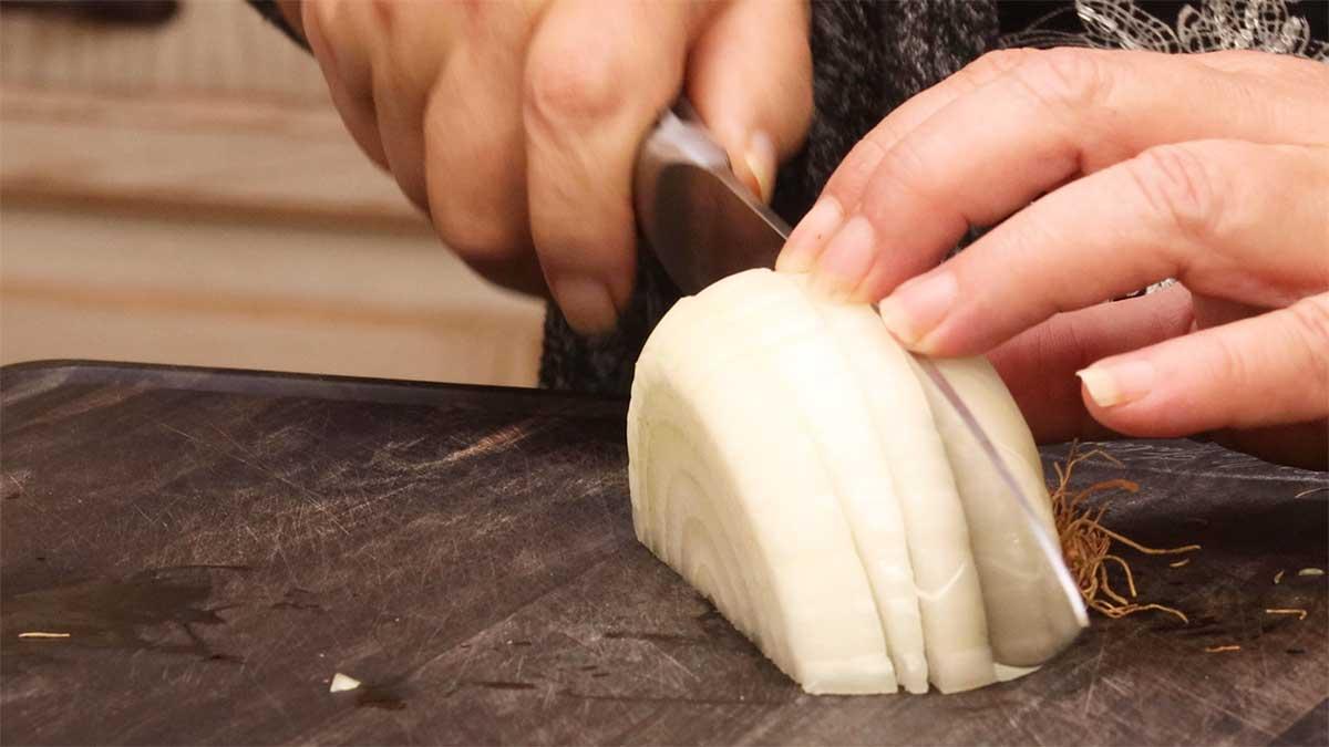slicing onion for chicken tinga