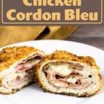 air fryer chicken cordon bleu cut in half on a white plate