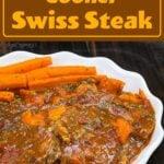 swiss steak on a platter with carrots