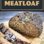 Air fryer meatloaf sliced on a cutting board