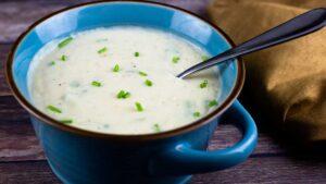 potato soup in a blue bowl